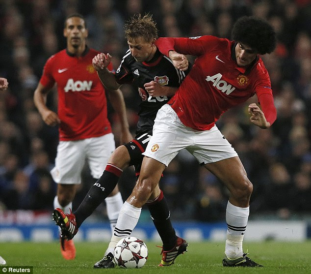 Stuck in: Marouane Fellaini (right) made his full debut for United on the big European stage