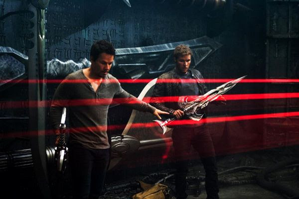 Cade Yeager and Shane Dyson (Jack Reynor) arm themselves with alien weaponry as they search for Tessa, Cade's daughter, aboard Lockdown's Knight Ship in TRANSFORMERS: AGE OF EXTINCTION.