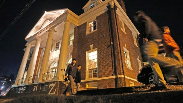 "FILE- In this Jan. 15, 2015 file photo shows students participate in rush pass by the Phi Kappa Psi house at the University of Virginia in Charlottesville, Va. The house was depicted in a debunked Rolling Stone story as the site of a rape in September of 2012. A defamation trial against the magazine is set to begin on Monday, Oct. 17, 2016, over its article about ""Jackie"" and her harrowing account of being gang raped in a fraternity initiation. (AP Photo/Steve Helber, File)"