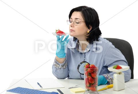 Authority expert smelling strawberries