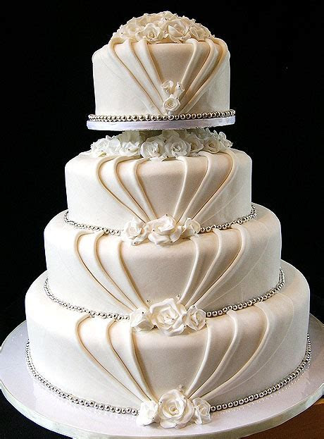 Elegant Wedding Cake with Roses and Silver Accents by