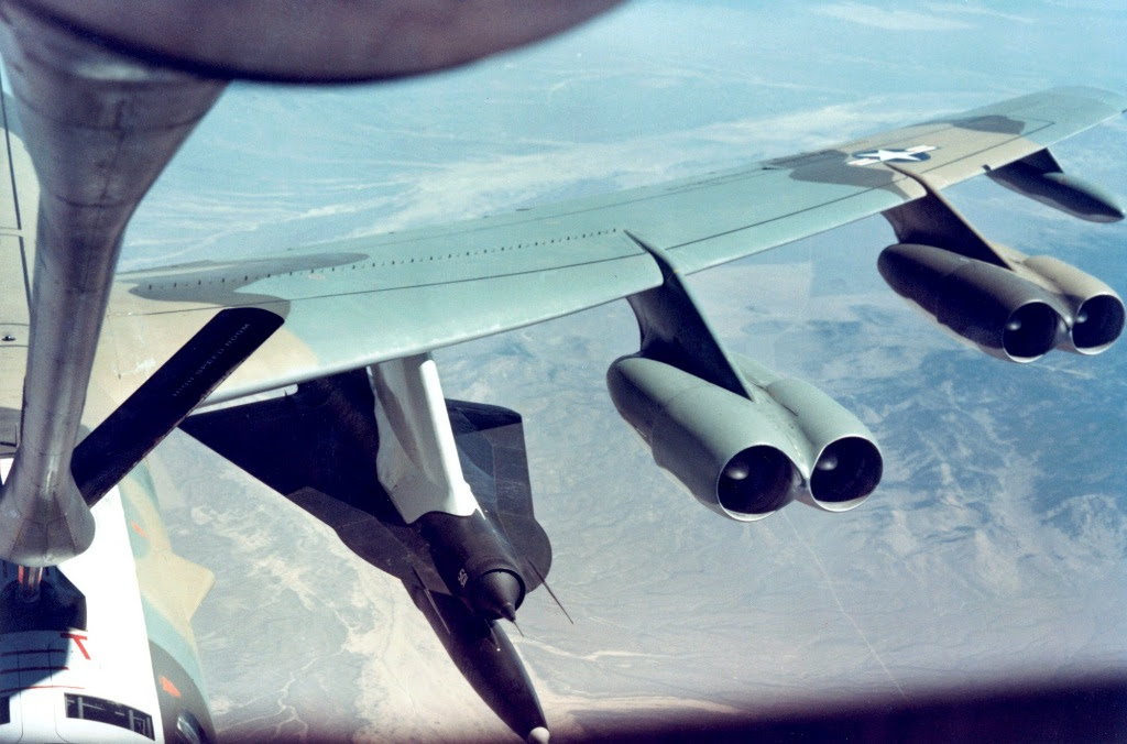 A B-52 carrying a D-21 reconnaissance drone and rocket booster.