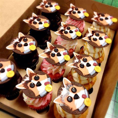 Cartoon corgi cupcake toppers made from fondant. Made