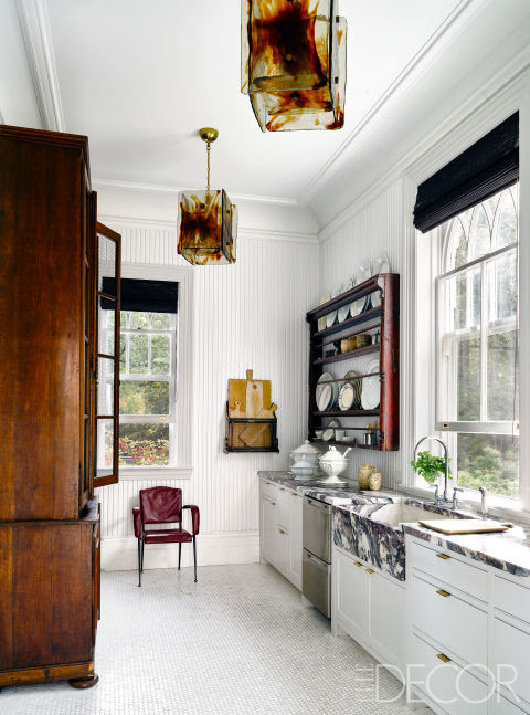 The kitchen counters and sink are custom made, and the dishwasher is by Fisher & Paykel.