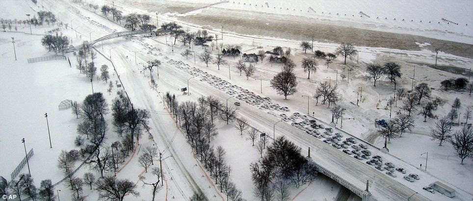 Hundreds of drivers on Lake Shore Drive in Chicago, which was blasted by 20 inches of snow, abandoned their cars in an almost apocalyptic scene as authorities closed the road
