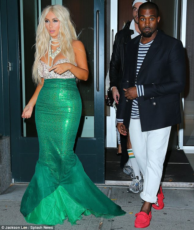 Any excuse: Kim certainly went all out for her costume while Kanye played it safe