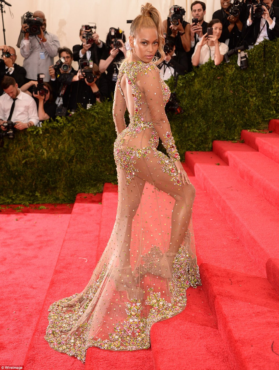 Stealing the show! Beyonce donned a sheer embellished Givenchy dress that strategically covered her assets when she attended the Met Gala in New York City on Monday
