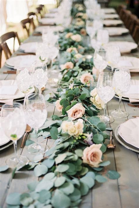 Simple table garland with white or soft pink roses/dahlias