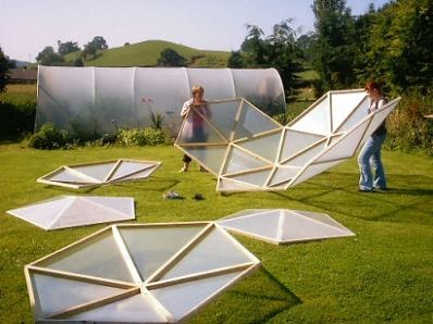 Homemade dome greenhouse homedesignpictures for Wooden greenhouse plans designs