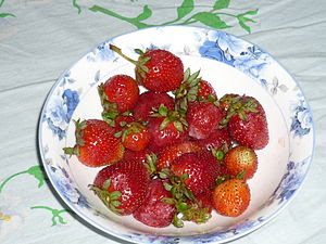 a Plate full of Strawberries.