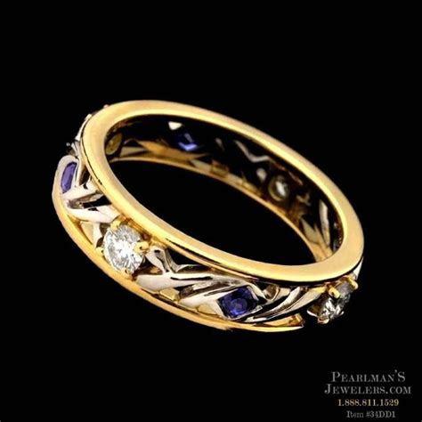 An elegant 18kt gold and platinum Arbor wedding ring by Mi..