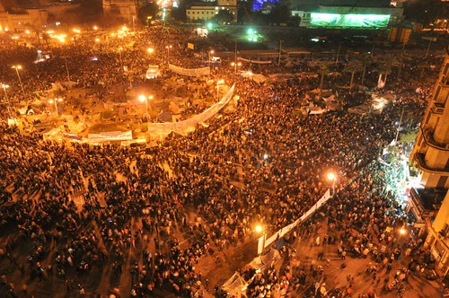 As seen from a ninth-floor apartment, Tahrir Square filled up considerably after nightfall the night after Mubarak resigned