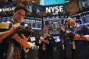 Traders work the floor at New York Stock Exchange in New York