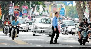 Maylasia Penang pred crossing in traffic Pulau Tikus