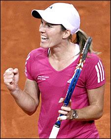 Justine Henin celebrates beating Jelena Jankovic