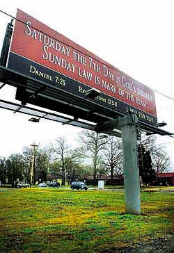 A billboard on Danville Road Southwest, the work of a Florida church, has upset some local people who worship on Sunday. It is not connected to a local Seventh-day Adventist Church.