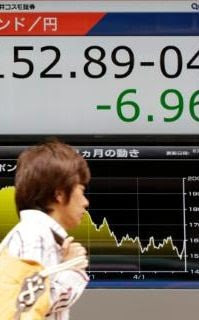 A man walks past an electronic board showing British pound/Japanese yen exchange rate at a securities firm in Tokyo