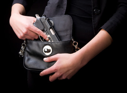 http://www.texasemployerhandbook.com/files/2011/10/pulling-gun-from-purse.jpg