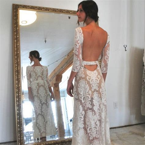 During fittings in For Love & Lemons San Marcos Maxi Dress