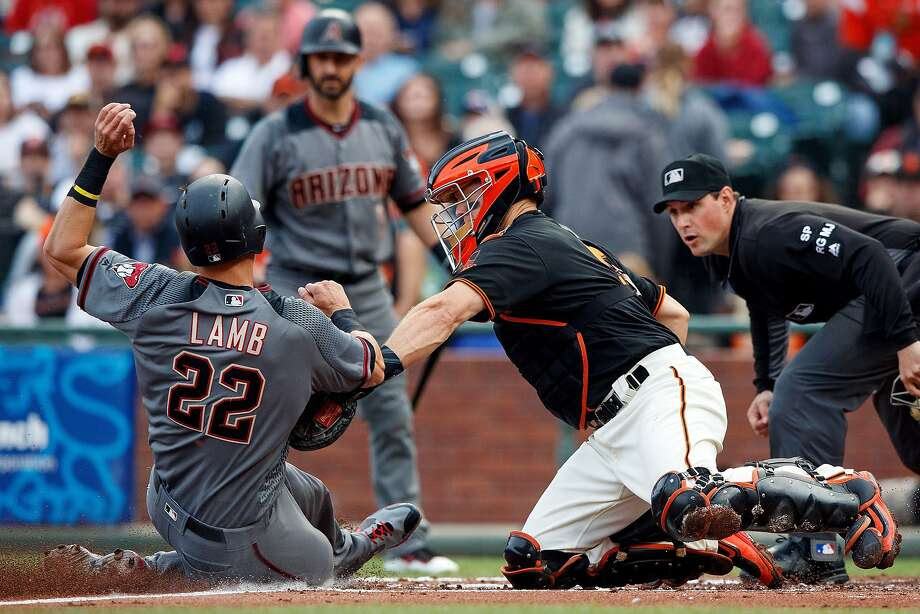 SAN FRANCISCO, CA - AUGUST 05: Jake Lamb #22 of the Arizona Diamondbacks is tagged out at home plate by Nick Hundley #5 of the San Francisco Giants during the first inning at AT&T Park on August 5, 2017 in San Francisco, California.  (Photo by Jason O. Watson/Getty Images) Photo: Jason O. Watson, Getty Images