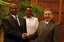 President Raul Castro of the Republic of Cuba greets Ugandan President Yoweri Museveni during his visit to the Caribbean island-nation. Museveni is accompanied by his wife shown in background. by Pan-African News Wire File Photos