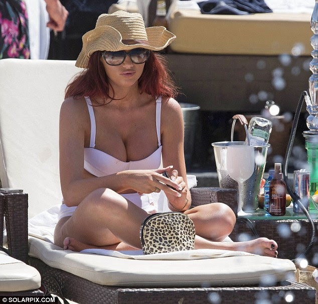 This is the life: Amy Childs relaxes in a white bikini at the La Sala Beach Club in Marbella on Wednesday