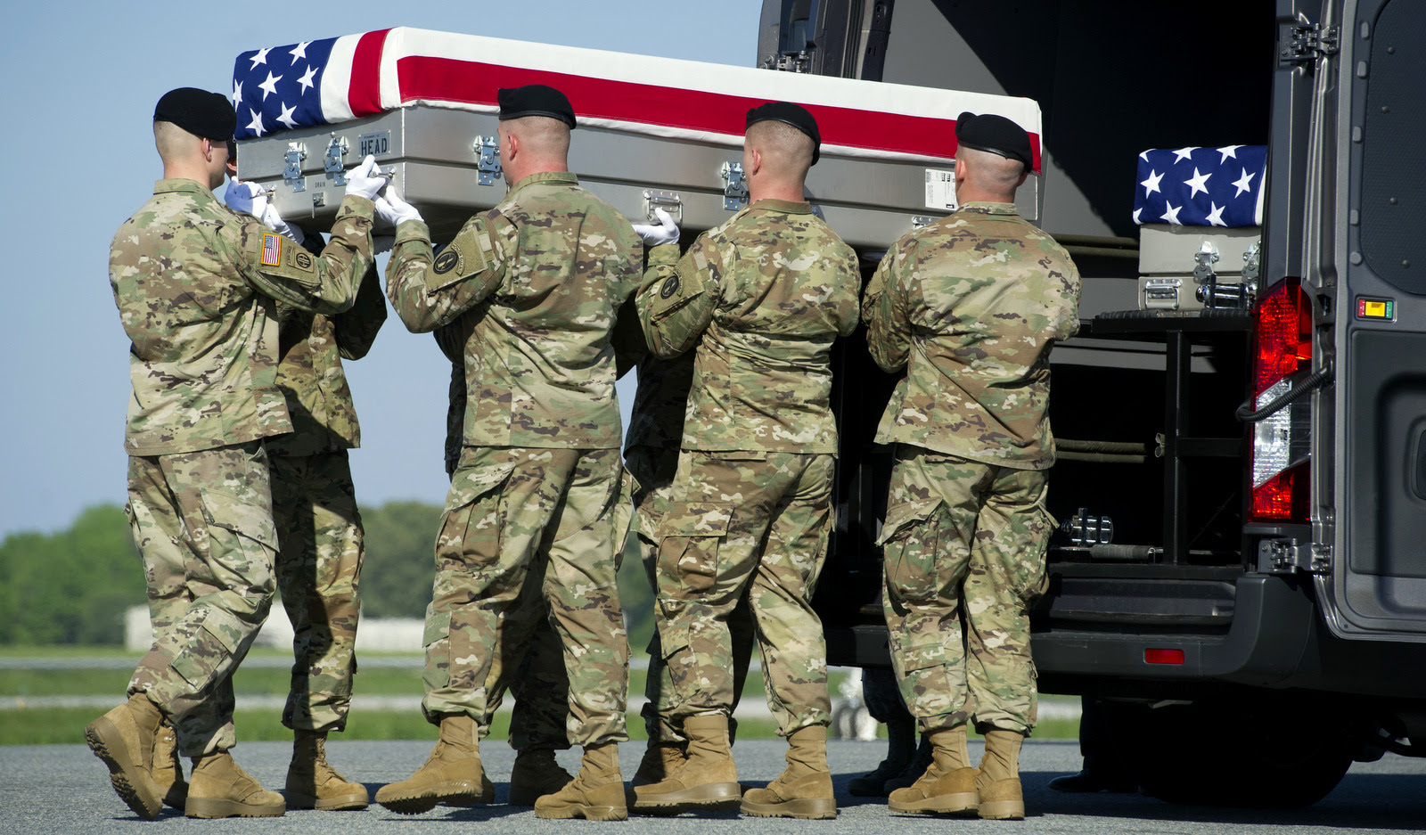 An Army carry team places the transfer case containing the remains of Army Sgt. Joshua Rodgers, 22, of Bloomington, Ill., who was killed during a raid on an alleged ISIS compound in eastern Afghanistan. (AP/Cliff Owen)