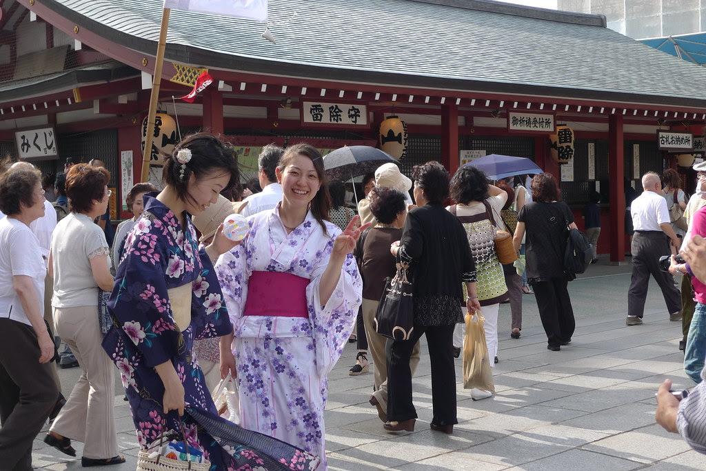 Candid photos of two girls in Yukata at senso-ji temple during hozuki ichii