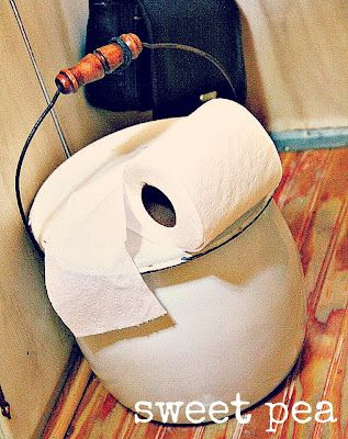 *tinkle tank*  .. a trash liner and tiny diaper ..  does the deed for midnight tinkles  {then tie up and throw it out}  sure beats hoofing it to the campground potty!