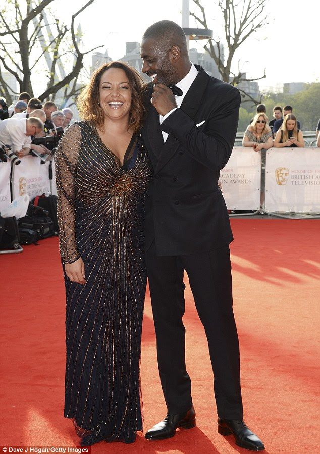 The look of love: Idris was seen walking the red carpet at London's Royal Festival Hall with his arm around his 28-year-old 'partner' as they paired made their first public appearance together this year