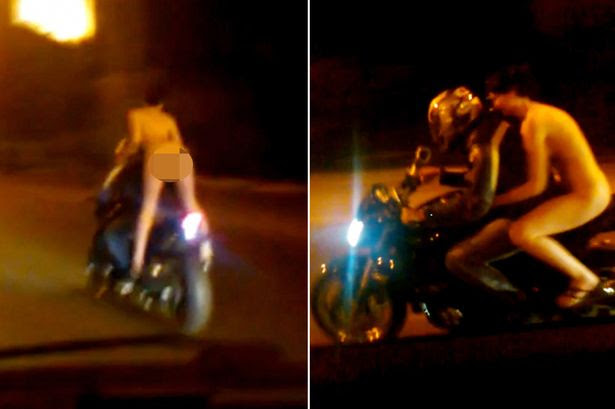 Police hunting motorcyclist after he carried a girl passenger who was completely naked
