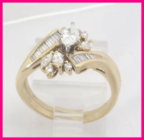 14k Yellow Gold Marquise & Baguette Round Diamond
