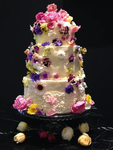 Using fresh flowers on wedding cakes.   Fresh Edible
