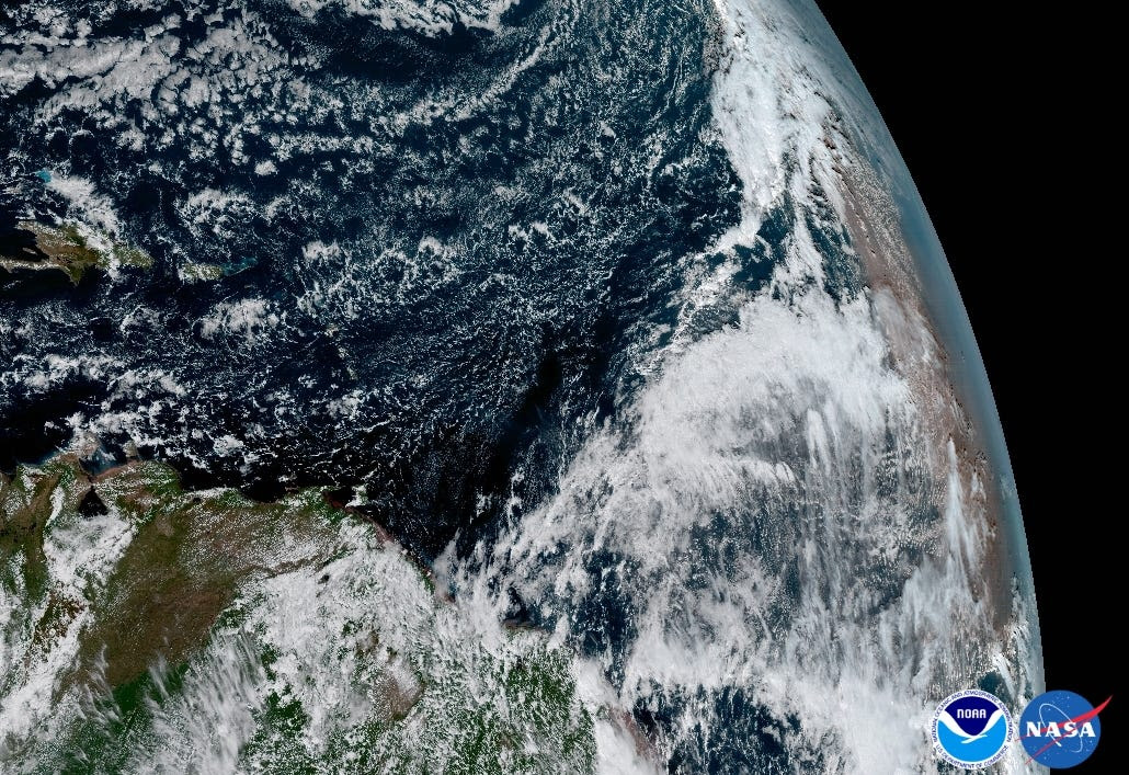 Dust from the Saharan Desert (right) blowing into the Atlantic Ocean.
