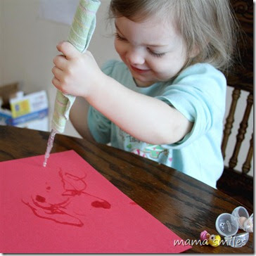 painting with an icicle on construction paper