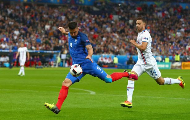 Olivier Giroud of France scores the opening goal during the UEFA EURO 2016 quarter final match between France and Iceland at Stade de France on July 3, 2016 in Paris, France.