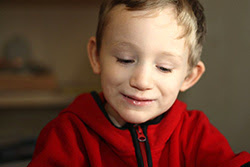 smiling boy in red shirt