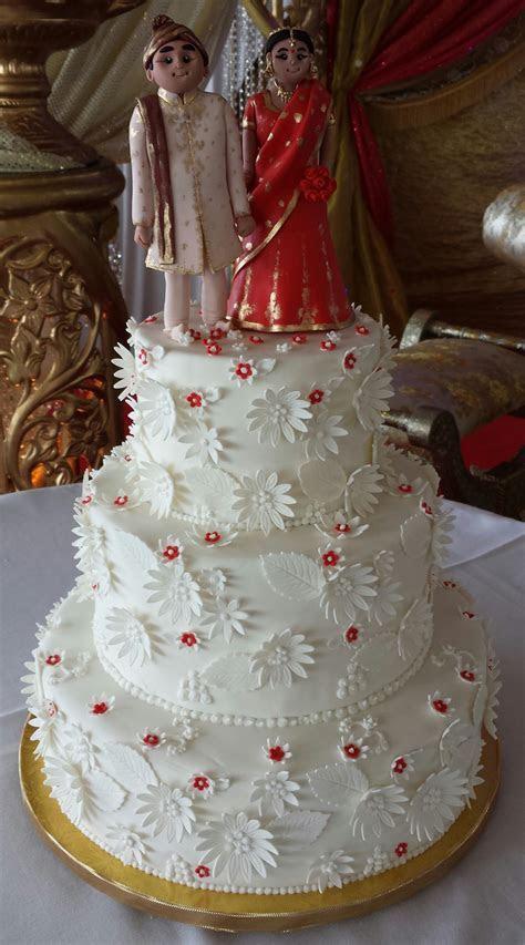 Wedding cake for a Bangladeshi couple with bride and groom