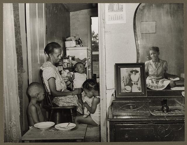 [Mrs. Ella Watson, a government charwoman, with three grandchildren and her adopted daughter]
