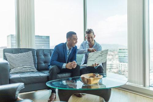 Businessmen using video conferencing platform