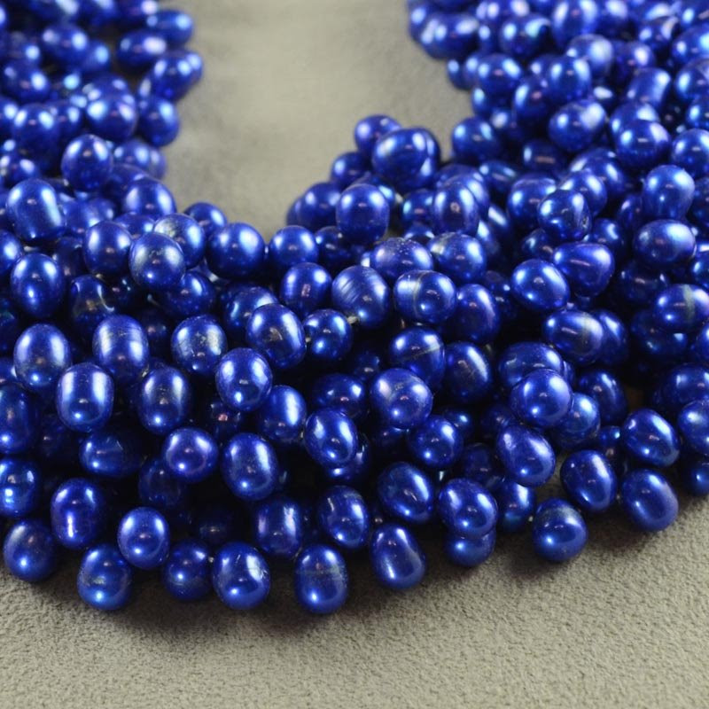 s35603 Freshwater Pearls - 8 x 6.5 mm Top Drill Bullet Pearl - Royal Blue (strand)