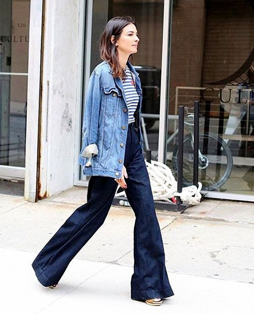 Le Fashion Blog Leila Yavari Navy Comme Des Garcons Striped Tee Oversize Distressed Denim Jacket Wide Leg Dark Jeans For Fall Via @Filleilamignon