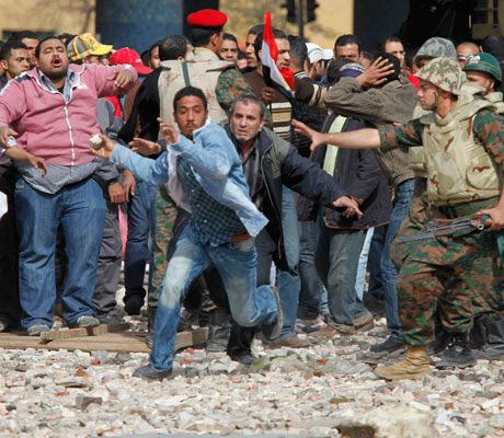 Mubarak supporter tries to get to opposition lines near Tahrir Square in Cairo