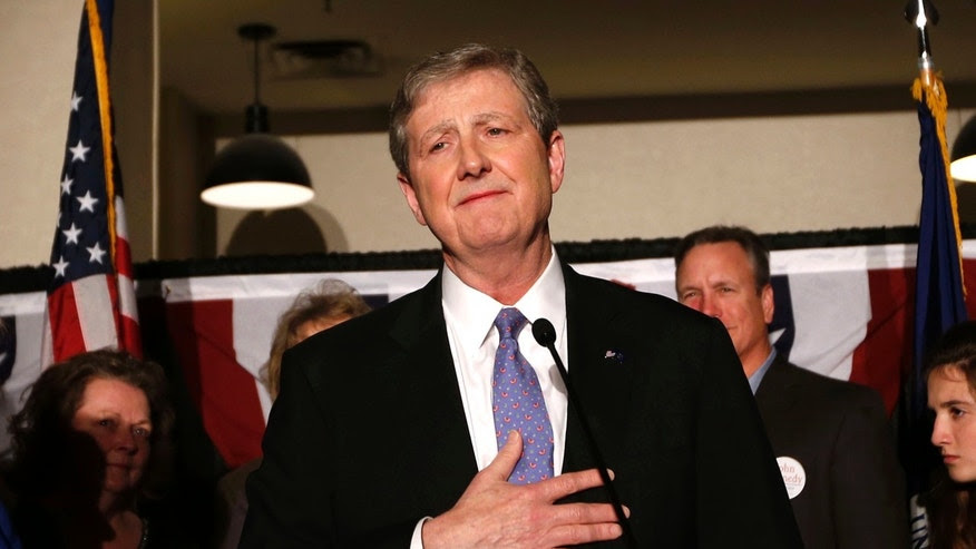 Louisiana state treasurer John Kennedy addresses supporters at his election watch party, after being elected to the senate seat vacated by Sen. David Vitter, R-La., in Baton Rouge, La., Saturday, Dec. 10, 2016. Left is his wife Becky Kennedy. (AP Photo/Gerald Herbert)