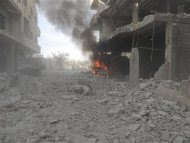 A car burns at a site hit by what activists said was shelling by forces loyal to Syria's President Bashar al-Assad in Arbaeen, near Damascus, May 23, 2013, in this picture provided by Shaam News Network. Diaa Al-Din/Shaam News Network/Handout via Reuters