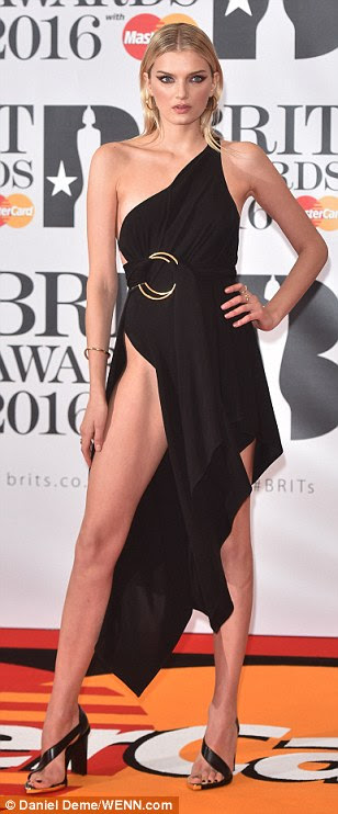 Legs for days: Lily Donaldson's asymmetric dress was also cut in a daring slash across her chest and was held together on the back by a delicate strap, but it was her stunning set of stems that really caught the eye