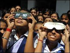 Indian girls test eclipse masks in Siliguri, 21 July 2009