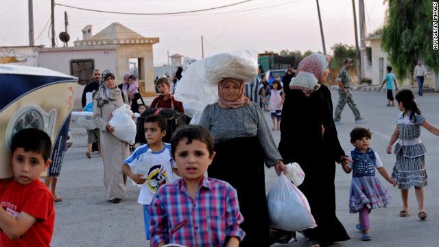Syrians flee Azaaz following the airstrike.