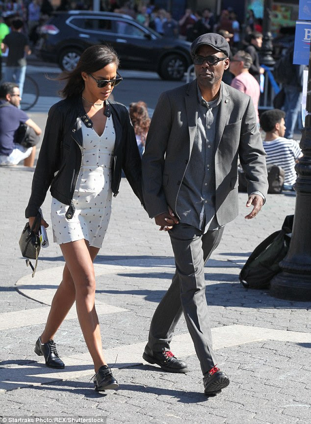 Manhattan Matinee: Chris Rock, 51, and girlfriend Megalyn Echikunwoke, 32, took a stroll around Times Square in New York after a trip to the theatre on Sunday