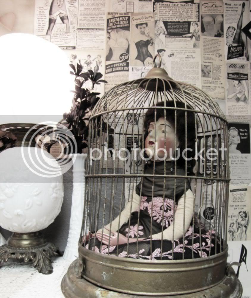boudoir doll in bird cage